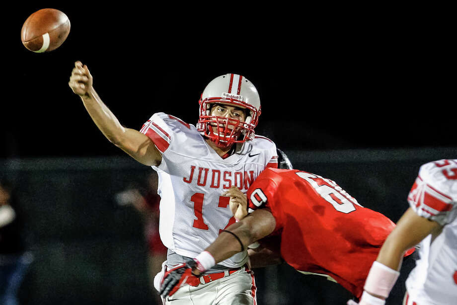 Judson quarterback Jonathan Garcia gets the ball off as he is being hit by Wagner's Jaden Moore during the second quarter of their game at Rutledge Stadium on Oct. 12, 2012.  MARVIN PFEIFFER/ mpfeiffer@express-news.net Photo: MARVIN PFEIFFER, Express-News / Express-News 2012