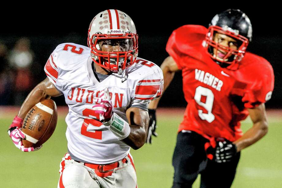 "Judson running back Jarveon Williams (left ) takes off on a first quarter run with Wagner's Eric Tilghmah in pursuit during the first quarter of their game at Rutledge Stadium on Oct. 12, 2012.  Judson won the ""Hammer Bowl"" 30-0.  MARVIN PFEIFFER/ mpfeiffer@express-news.net Photo: MARVIN PFEIFFER, Express-News / Express-News 2012"