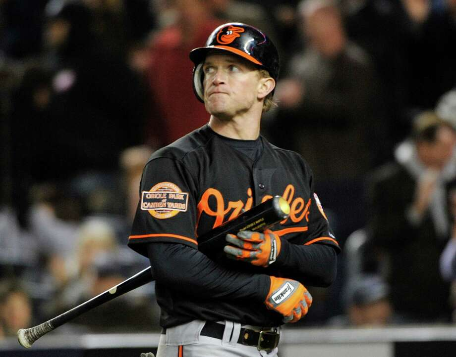 The Orioles' Nate McLouth just missed a game-tying homer. Photo: Bill Kostroun / FR59151 AP