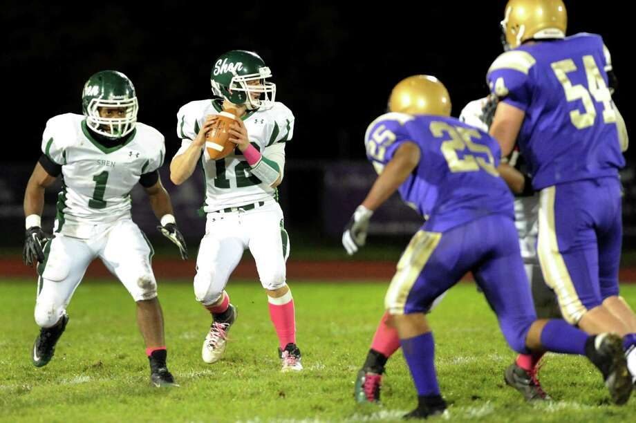 Shenendehowa's quarterback Ryan Buss (12), center, looks to pass during their football game against CBA on Friday, Oct. 12, 2012, at Christian Brothers Academy in Colonie, N.Y. At left is Shen's Marcelino Christie (1). (Cindy Schultz / Times Union) Photo: Cindy Schultz / 00019606A
