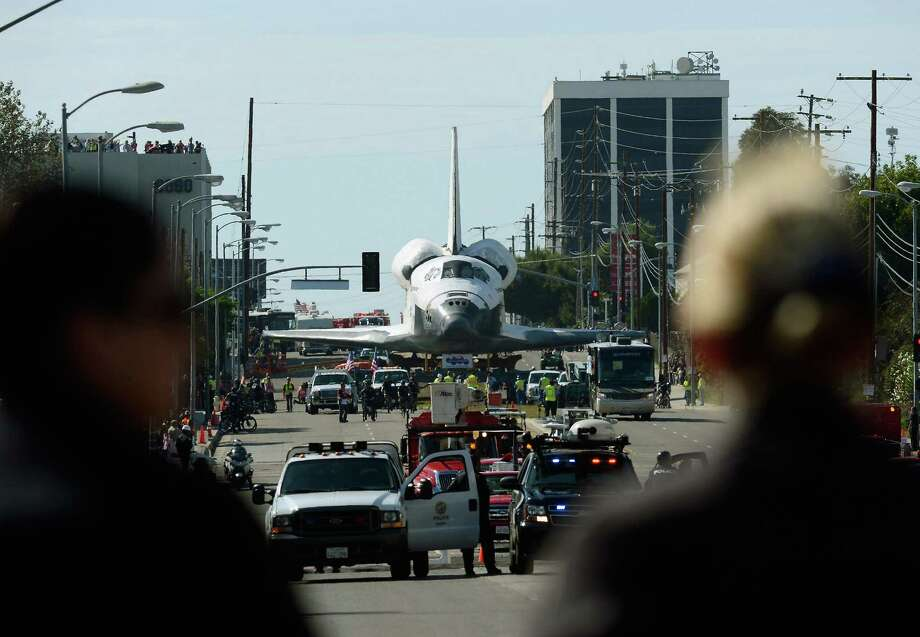 The space shuttle Endeavour is transported to the California Science Center in Exposition Park from Los Angeles International Airport (LAX) on October 12, 2012 in Los Angeles, California. Endeavour was flown cross-country atop NASA's Shuttle Carrier Aircraft from Kennedy Space Center in Florida to LAX on its last flight ever on September 21. From there, it was transported to the California Science Center in Exposition Park where it will be on permanent public display. Completed in 1991, Endeavour was built to replace the space shuttle Challenger which disintegrated during a catastrophic re-entry accident. This fifth and final space shuttle orbiter circled the earth 4,671 times and traveled nearly 123 million miles during its 25 missions from 1992 to 2011. Photo: Kevork Djansezian, Getty Images / 2012 Getty Images