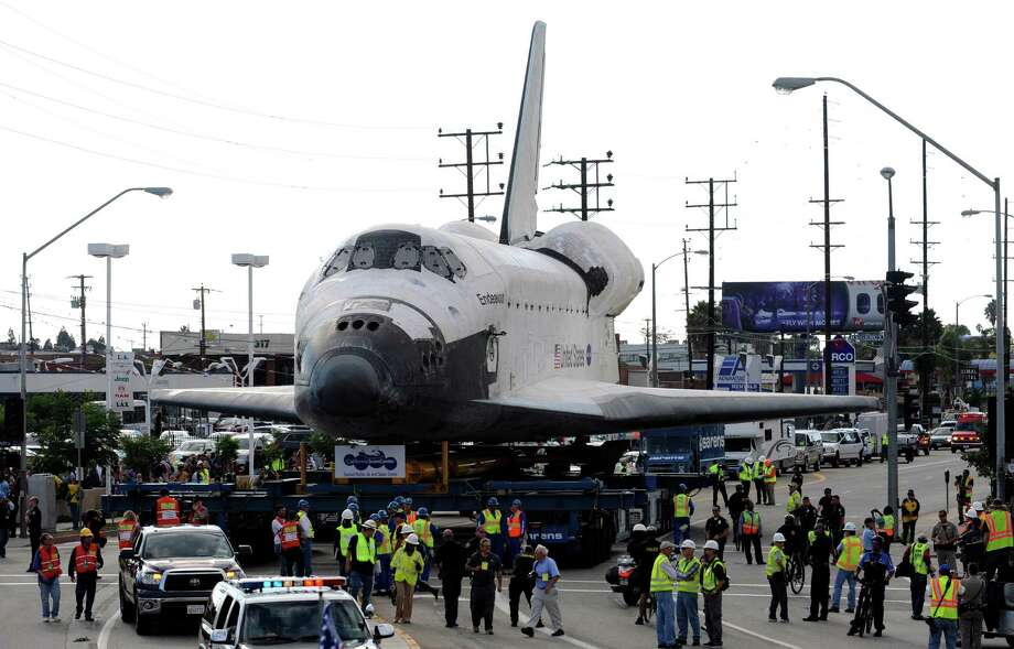 Crowds gather to get a glimpse of the Space Shuttle Endeavour along Manchester Blvd., as it is transported to California Science Center on October 12, 2012 in Los Angeles, California. Photo: Pool, Getty Images / 2012 Getty Images