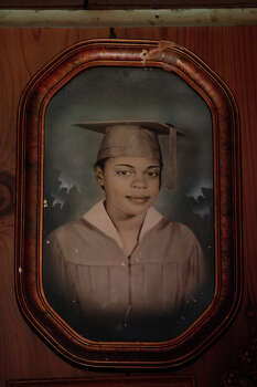 "A graduation picture of Beatrice ""Aunt Bea"" Gee Beaty hangs on the wall in the home of her nephew, Freddy Carruthers, at his home in Pelham. Aunt Bea passed away in April, the oldest resident, and a native, in Pelham at the age of 95. Photo: Lisa Krantz, San Antonio Express-News / © 2012 San Antonio Express-News"