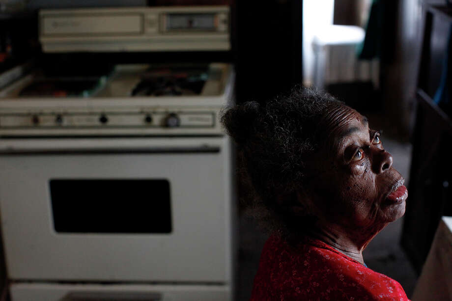 "The oldest Pelham resident and native, Beatrice ""Aunt Bea"" Gee Beaty, 95, sits in her kitchen in the trailer she lived in next to her nephew, Frederick Carruthers, shortly before her death Pelham in April. ""We don't cook like we used to but we still love to eat,"" Aunt Bea said as she sat down for a lunch prepared by Carruthers' wife. Carruthers often takes plates of food to elderly residents. Photo: Lisa Krantz, San Antonio Express-News / © 2012 San Antonio Express-News"