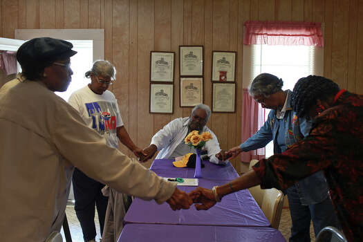 Members of the Pelham Community Activity Committee including Catherine Porter, from left, Maurice Jefferson, Alva Jean Porter and Darlene Holloway pray after their monthly meeting in March at the Pelham Community Center. Joining the women is Nathaniel Barnett, center, whose wife was born and raised in Pelham. Photo: Lisa Krantz, San Antonio Express-News / © 2012 San Antonio Express-News