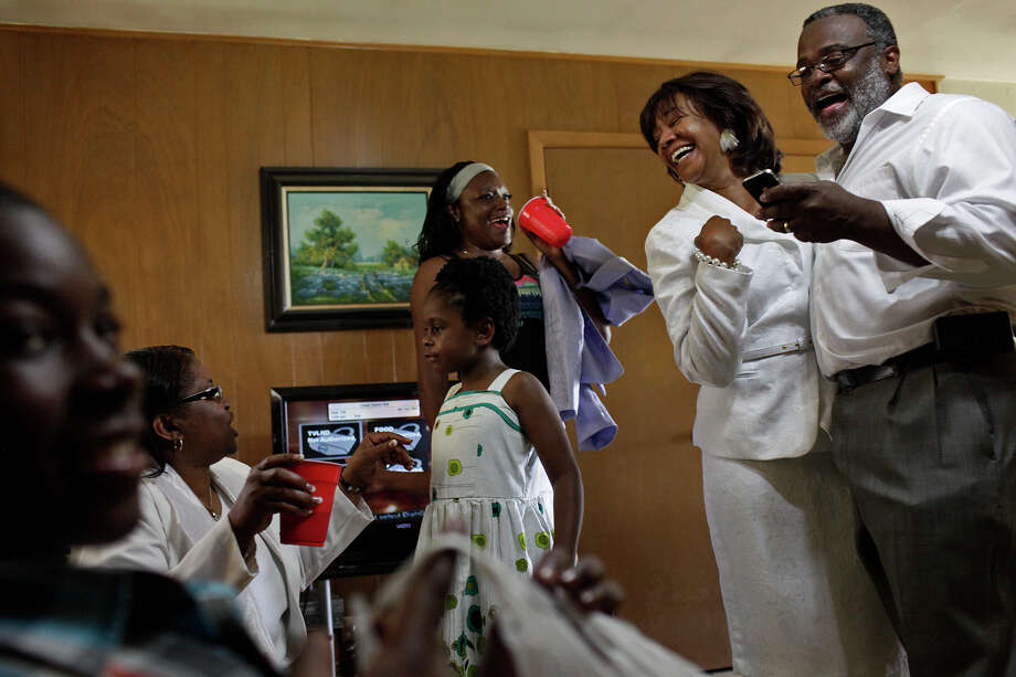 Yvonne McNeil-Weaver and her husband, Rev. Dennis A. Weaver, right, celebrate Easter with members of their church, Brown Chapel A.M.E Church, at the home of Pelham resident Ted Brackens after the church service. Yvonne is a descendant of the Cook family in Pelham and moved to her family's land three years ago. She hopes to build a new home there and live their permanently with her family, including her teenage daughter. Photo: Lisa Krantz, San Antonio Express-News / © 2012 San Antonio Express-News