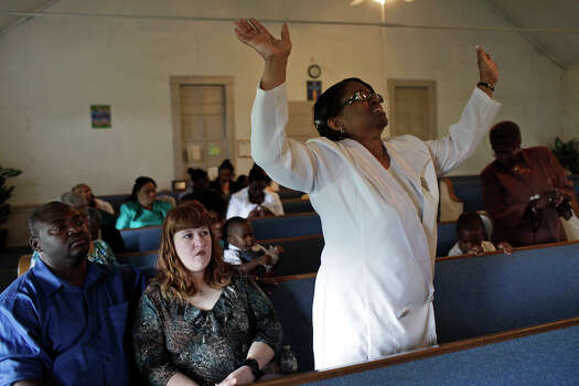 Pastor Rosa Kea, who comes from Killeen to pastor AME Brown Chapel, worships at the church in Pelham on Easter Sunday, April 8, 2012. Photo: Lisa Krantz, San Antonio Express-News / © 2012 San Antonio Express-News