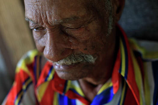 Pelham native Elvis Caruthers, 90, cries as he talks about his wife, who died more than 10 years ago. He now lives alone on the land he was born on. Photo: Lisa Krantz, San Antonio Express-News / © 2012 San Antonio Express-News