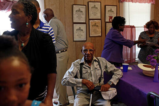 Pelham native J.B. Porter, 94, the oldest living resident of Pelham, takes a seat amid a gathering at the Pelham Community Center in August. Porter's wife, Catherine, is one of the women keeping the community alive. Photo: Lisa Krantz, San Antonio Express-News / © 2012 San Antonio Express-News