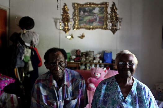 Married for 60 years, Stella Parks, 78, and Odell Parks, 79, sit on their bed in their Pelham home on August 13, 2012. The couple have 12 children who were all raised in Pelham, most of them still living nearby. Odell's mother was a midwife and delivered 10 of their children. Photo: Lisa Krantz, San Antonio Express-News / © 2012 San Antonio Express-News