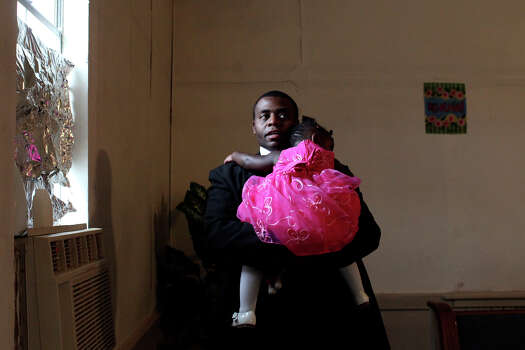 Jeremiah Adell, of Killeen, holds his daughter, Taniyah Faith Adell, 1, during the 107th year anniversary celebration at Brown Chapel A.M.E Church in Pelham on August 26, 2012. The pastor of the church lives in Killeen and members of her church there often attend services in Pelham as well. Photo: Lisa Krantz, San Antonio Express-News