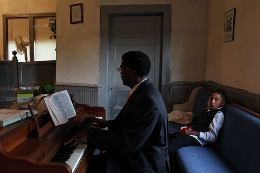 Cedric Sanderlin plays the piano during the 107th year anniversary of Brown Chapel A.M.E Church in Pelham. Photo: Lisa Krantz, San Antonio Express-News / © 2012 San Antonio Express-News