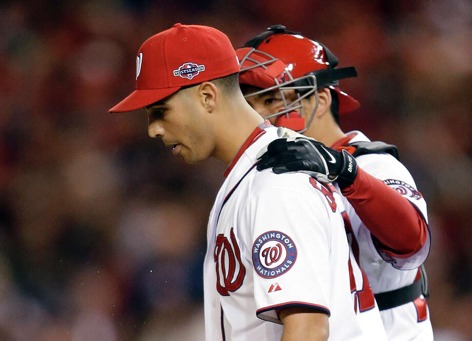 Washington Nationals catcher Kurt Suzuki, back, speaks with starting pitcher Gio Gonzalez after Gonzalez walked St. Louis Cardinals' Shane Robinson in the fifth inning of Game 5 of the National League division baseball series on Friday, Oct. 12, 2012, in Washington. (AP Photo/Pablo Martinez Monsivais) Photo: Pablo Martinez Monsivais / AP
