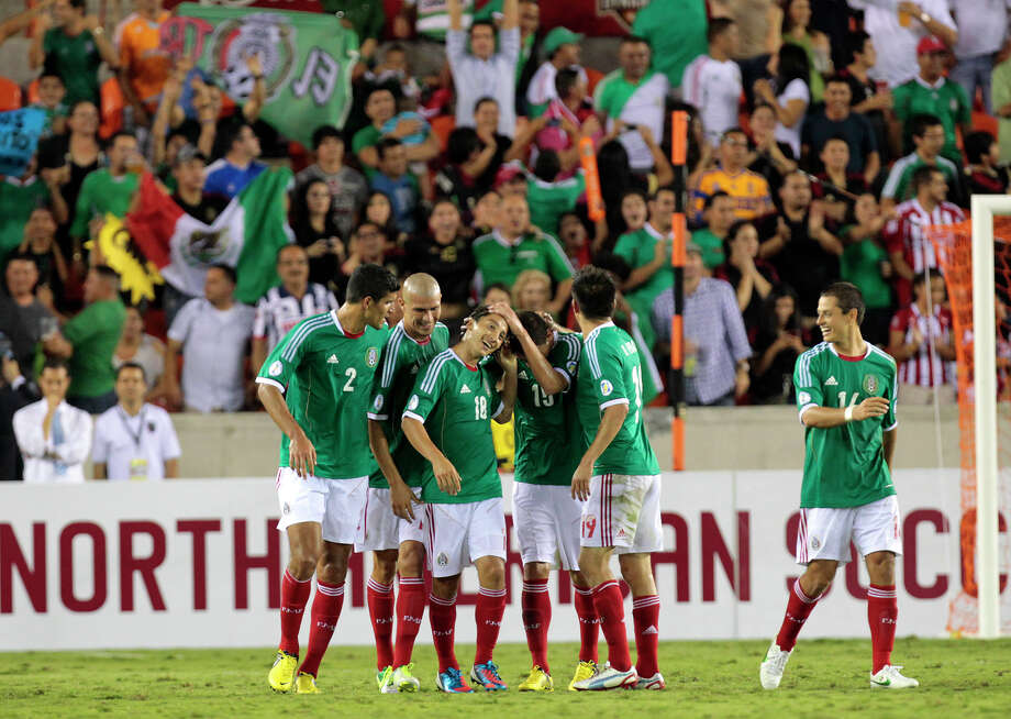 Mexico celebrates after Andrés Guardado (18) scored a goal during the second half of the FIFA World Cup qualifying match against Guyana at BBVA Compass Stadium. Mexico won 5-0. Photo: Cody Duty / © 2012 Houston Chronicle