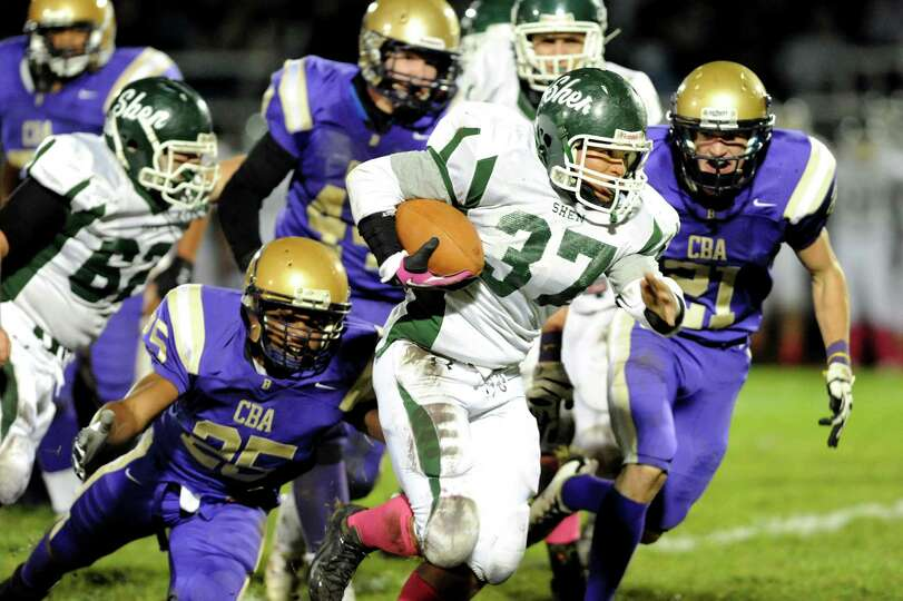 Shenendehowa's Oliver Robinson (37), center, gains yards during their football game against CBA on F