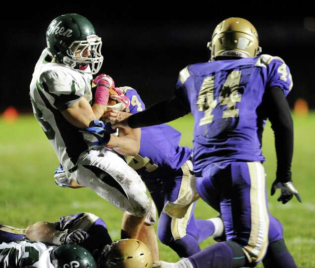 Shenendehowa's Kyle Buss (23), left, stops short of the end zone during their football game against