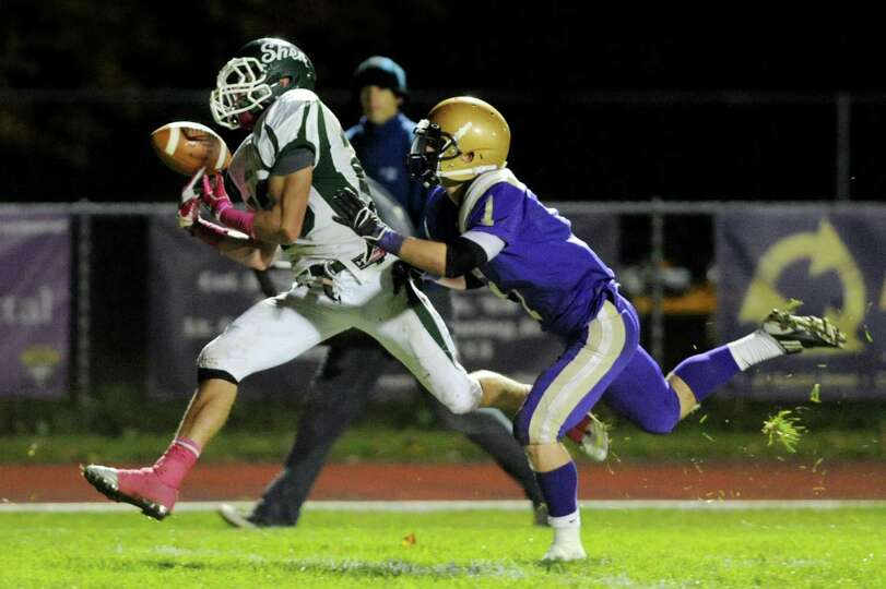 Shenendehowa's Kyle Buss (23), left, can't hold onto the ball as CBA's Jonas Neri (1) defends during