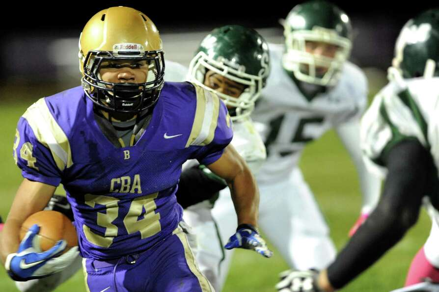 CBA's Cameron Wynn (34), left, gains yards during their football game against Shenendehowa on Friday
