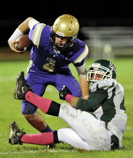 CBA's quarterback Troy Anthony (4), left, tries to shake Shenendehowa defender Lucas Buckley (42) du