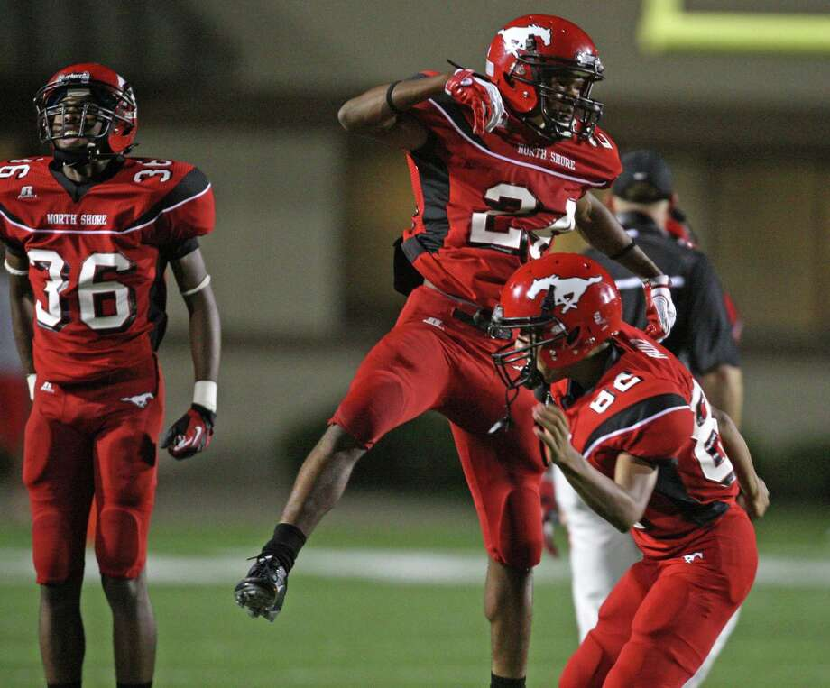 North Shore's Bryce Alley (24) celebrates the Mustangs' 31-24 victory over the Port Arthur Memorial Titans, Friday, October 12, 2012 at Galena Park ISD Stadium in Houston, TX. Photo: Eric Christian Smith, For The Chronicle