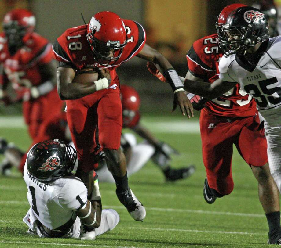 North Shore's Micah Thomas (18) is tackled by Port Arthur Memorial's Jalen Barnes during the first half of a high school football game, Friday, October 12, 2012 at Galena Park ISD Stadium in Houston, TX. Photo: Eric Christian Smith, For The Chronicle