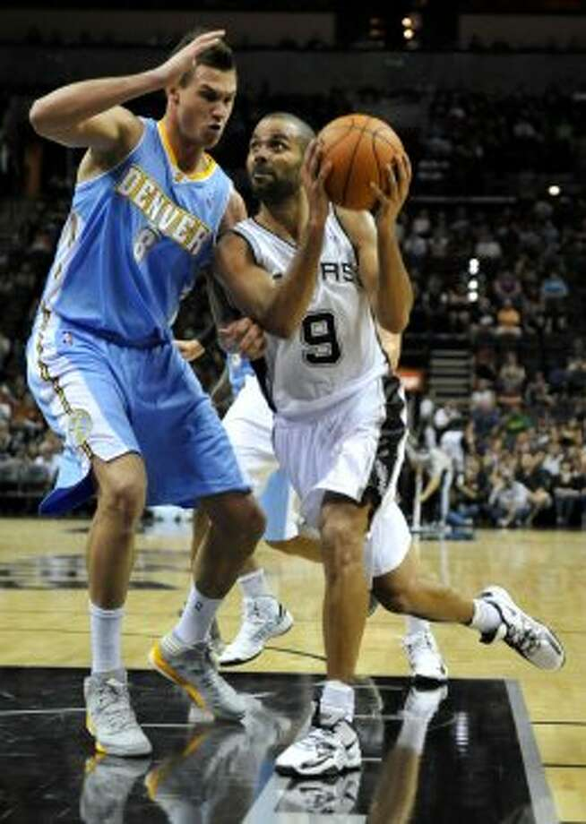 San Antonio Spurs guard Tony Parker, right, of France, drives against Denver Nuggets forward Danilo Gallinari, of Italy, during the first half of an NBA preseason basketball game on Friday, Oct. 12, 2012, in San Antonio. (Bahram Mark Sobhani / Associated Press)