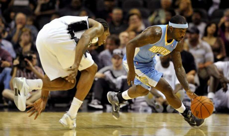 Denver Nuggets guard Ty Lawson, right, steals the ball from San Antonio Spurs forward Kawhi Leonard during the first half of an NBA preseason basketball game on Friday, Oct. 12, 2012, in San Antonio. (Bahram Mark Sobhani / Associated Press)