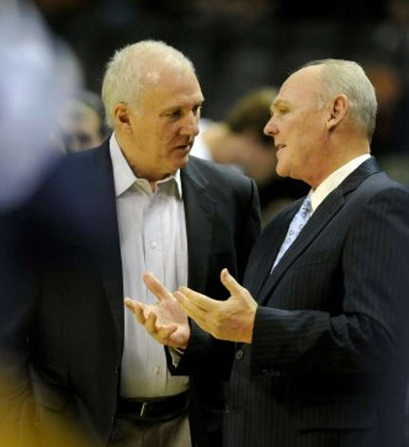 San Antonio Spurs coach Gregg Popovich visits with Denver Nuggets coach George Karl before the first half of an NBA preseason basketball game on Friday, Oct. 12, 2012, in San Antonio. (Bahram Mark Sobhani / Associated Press)