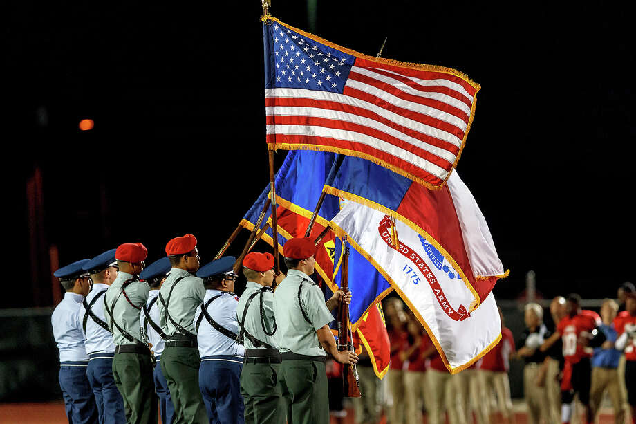 The Judson JROTC flies the colors as the National Anthm is sung during their game with Wagner at Rutledge Stadium on Oct. 12, 2012.  MARVIN PFEIFFER/ mpfeiffer@express-news.net Photo: MARVIN PFEIFFER, Express-News / Express-News 2012