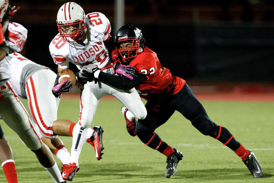 "Wagner's Byron Mills (right) brings down Judson running back Brandon Sannders during the fourth quarter of their game at Rutledge Stadium on Oct. 12, 2012. Judson won the ""Hammer Bowl"" 30-0.  MARVIN PFEIFFER/ mpfeiffer@express-news.net Photo: MARVIN PFEIFFER, Express-News / Express-News 2012"