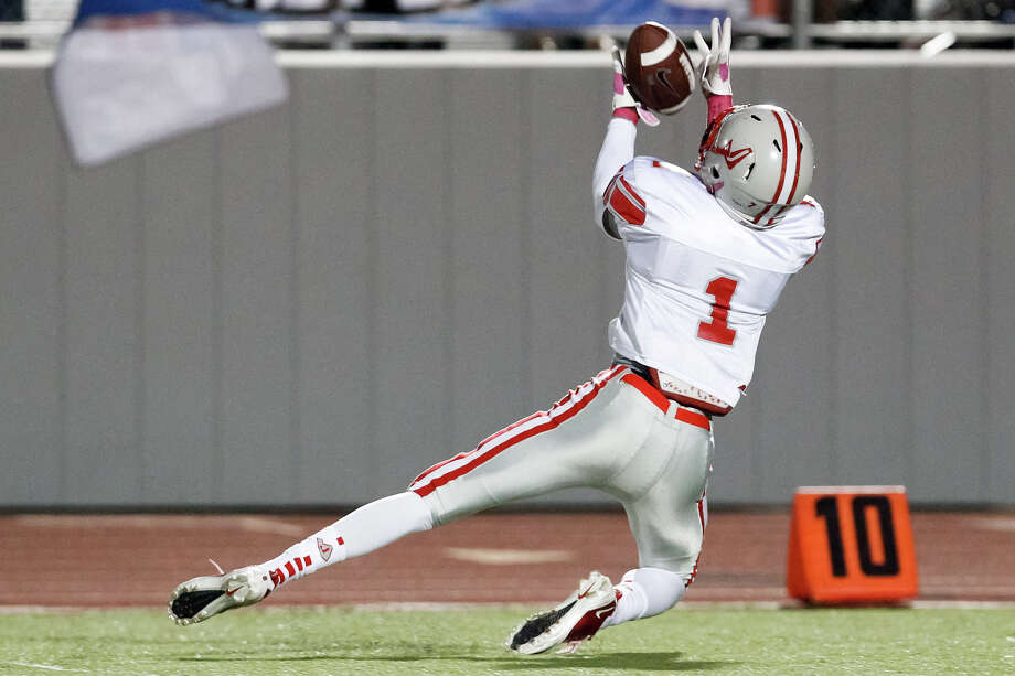 "Judson's Rashawn Morrison intercepts a pass to stop a Wagner drive during the third quarter of their game at Rutledge Stadium on Oct. 12, 2012.  Judson won the ""Hammer Bowl"" 30-0.  MARVIN PFEIFFER/ mpfeiffer@express-news.net Photo: MARVIN PFEIFFER, Express-News / Express-News 2012"