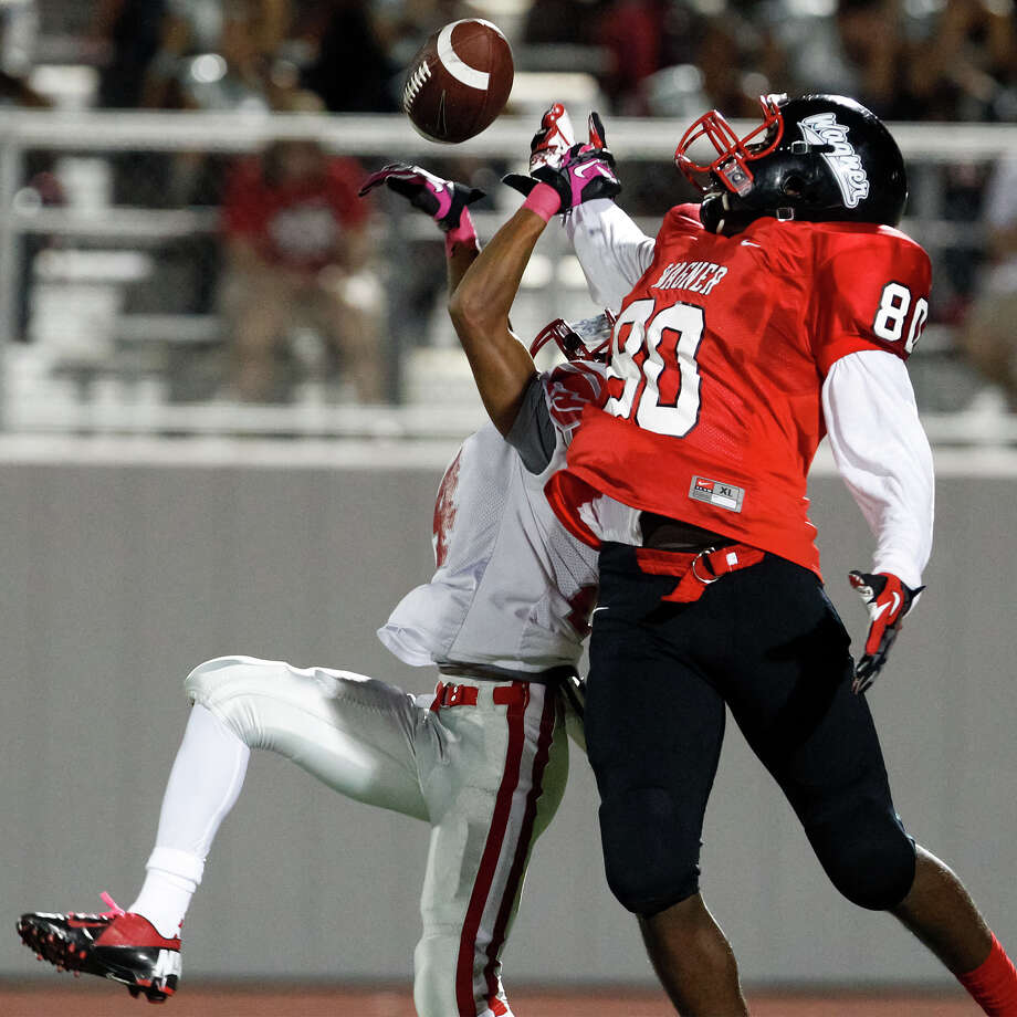 """Wagner's Khalil Bragg-Morriss (right) and Judson's Jaquori  Brooks fight for a ball during the third quarter of their game at Rutledge Stadium on Oct. 12, 2012.  Judson won the """"Hammer Bowl"""" 30-0.  MARVIN PFEIFFER/ mpfeiffer@express-news.net Photo: MARVIN PFEIFFER, Express-News / Express-News 2012"""