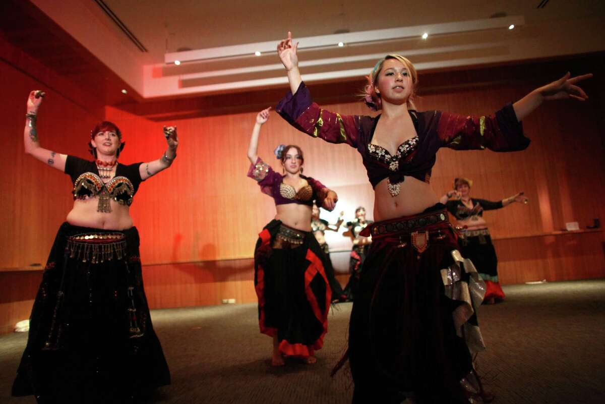 From left, bellydancer Katrina, Katya Downey and Katarina Shih dance during Elles: Community Night Out on Friday, October 12, 2012 at the Seattle Art Museum. The night out celebrated women's contribution to the arts and SAM's new Elles: Pompidou exhibition.