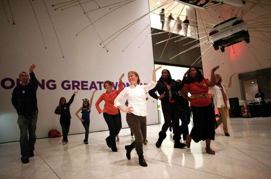 Participants dance to Madonna's song 'Vogue' during a performance during Elles: Community Night Out on Friday, October 12, 2012 at the Seattle Art Museum. The night out celebrated women's contribution to the arts and SAM's new Elles: Pompidou exhibition. Photo: JOSHUA TRUJILLO / SEATTLEPI.COM