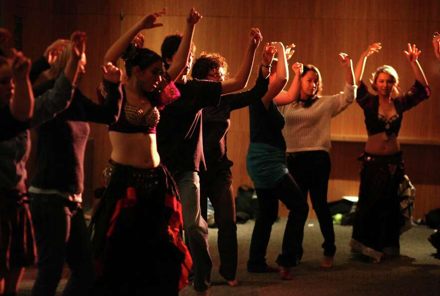 Participants learn to belly dance during Elles: Community Night Out on Friday, October 12, 2012 at t