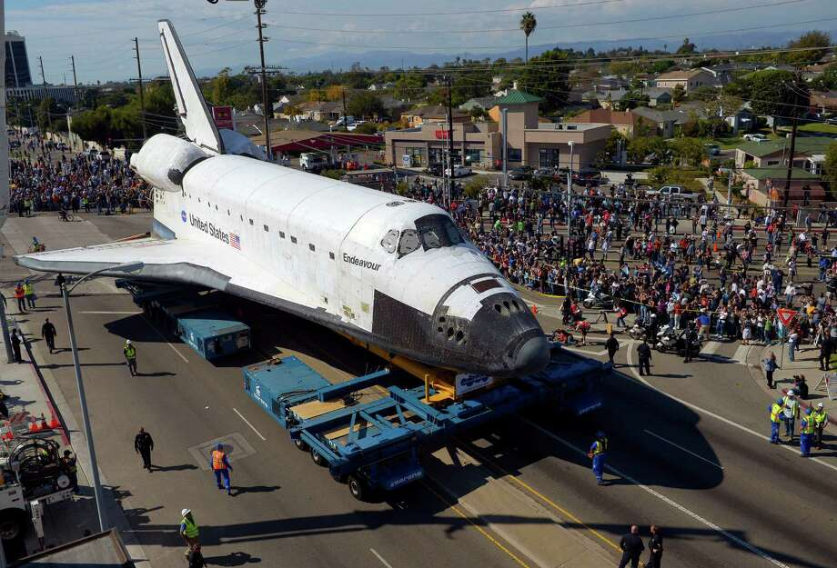 The Space Shuttle Endeavour slowly moves along city streets on a 160-wheeled carrier, Friday, Oct. 12, 2012, in Los Angeles. Photo: Mark J. Terrill / Associated Press