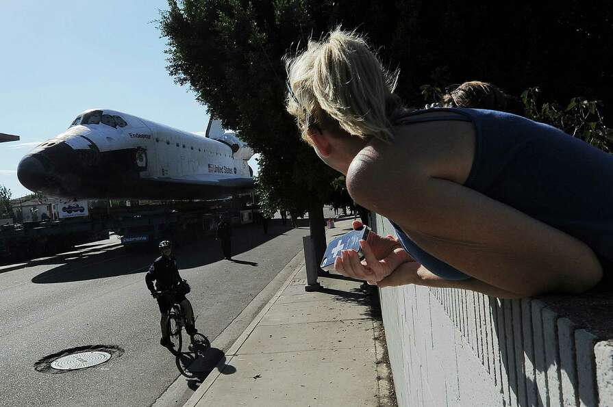 The US Space Shuttle Endeavour is moved from Westchester Square to Randy's Donuts.
