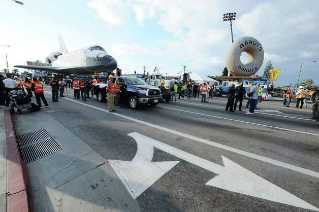 Space shuttle Endeavour travels 12 miles through city streets from Los Angeles International Airport to it's final location at the California Science Center. Photo: Katy Winn / Associated Press