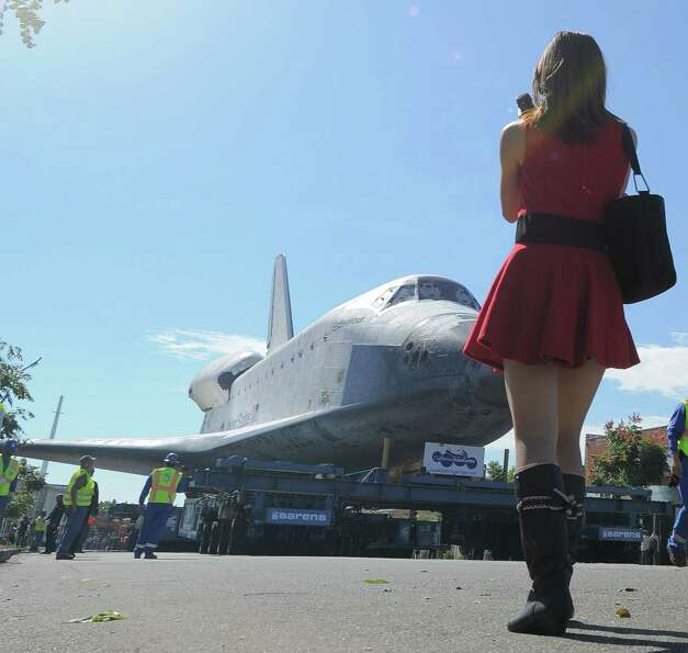 Space Shuttle Endeavour is seen en route from Westchester square to Randy's Donuts.