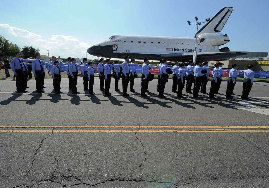 Space Shuttle Endeavour is shown during its final ground journey  in  Los Angeles. Photo: Joe Klamar / AFP/Getty Images