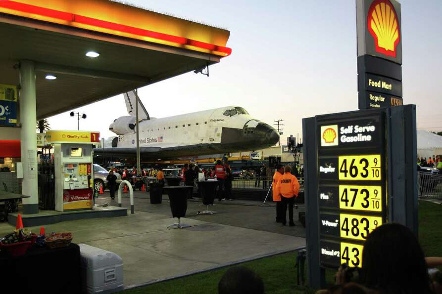 People gather as the space shuttle Endeavour is transported to the California Science Center in Expo