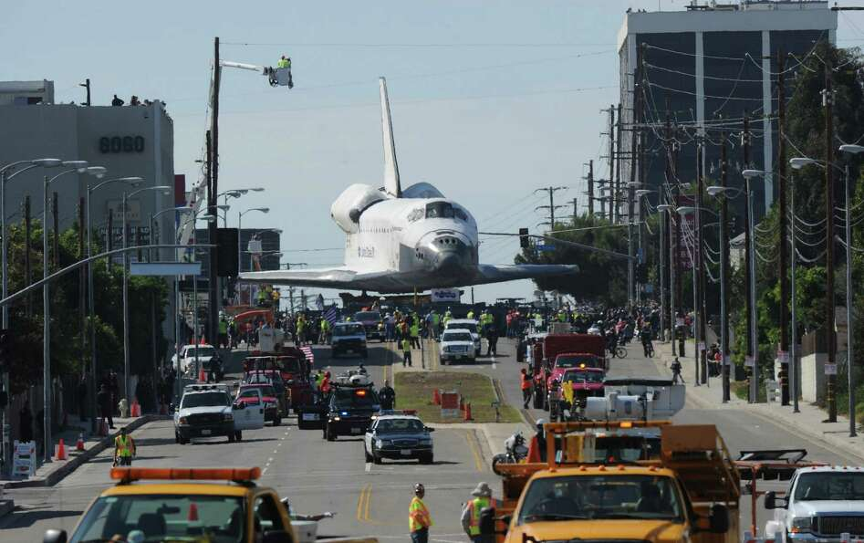 The Space Shuttle Endeavour is transported through the streets of Los Angeles.