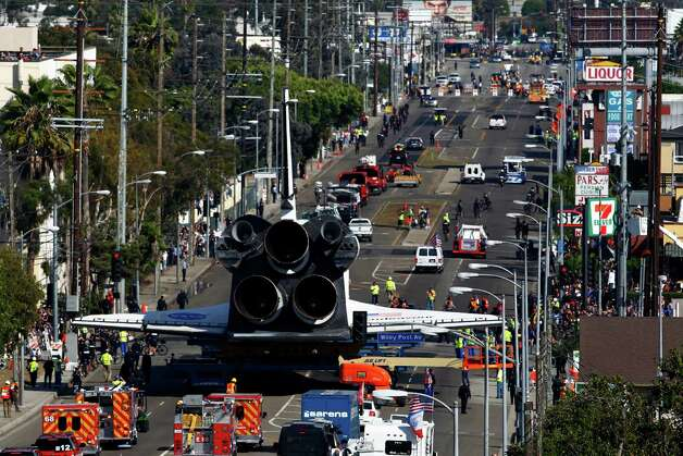 Spectators gather to watch the space shuttle Endeavour slowly move along city streets. Photo: Patrick T. Fallon / Associated Press