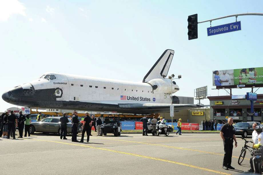 Space shuttle Endeavour travels 12 miles through city streets. Photo: Katy Winn / Associated Press