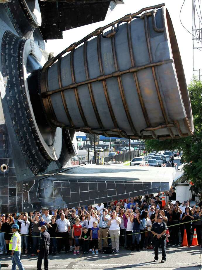 Spectators watch as the Space Shuttle Endeavour slowly moves along city streets. Photo: Jae C. Hong / Associated Press