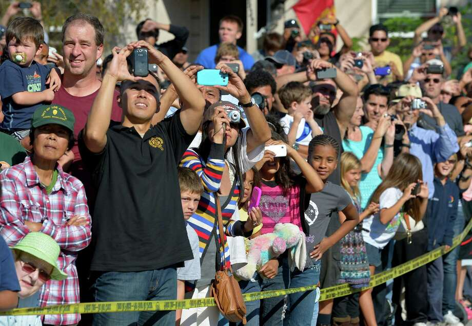 Spectators take pictures of the Space Shuttle Endeavour. Photo: Mark J. Terrill / Associated Press