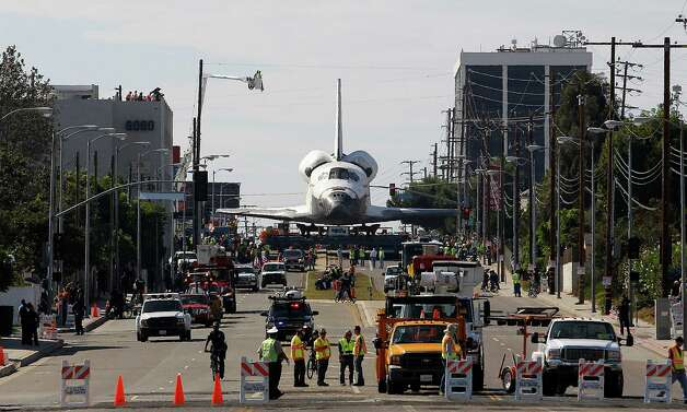 The Space Shuttle Endeavour slowly moves along city streets. Photo: Jae C. Hong / Associated Press