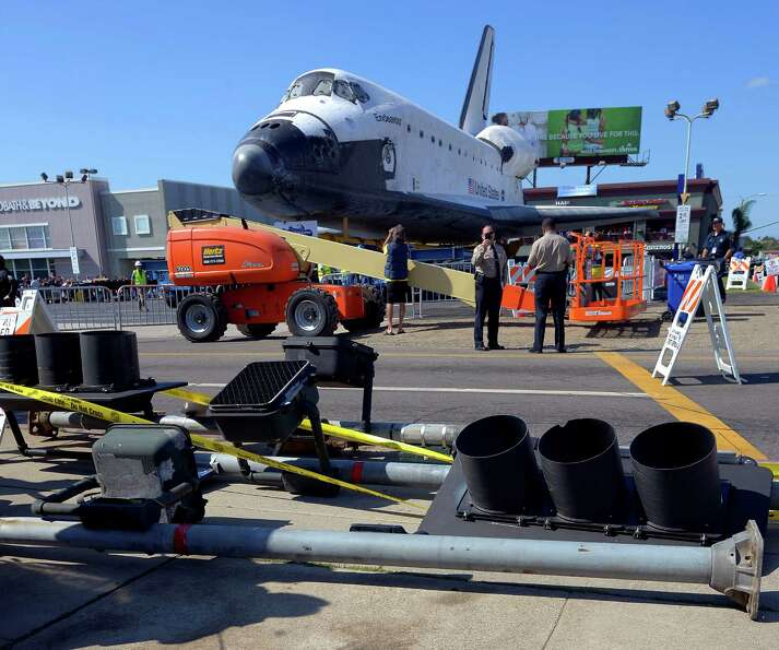 The Space Shuttle Endeavour sits before it is moved along city streets.