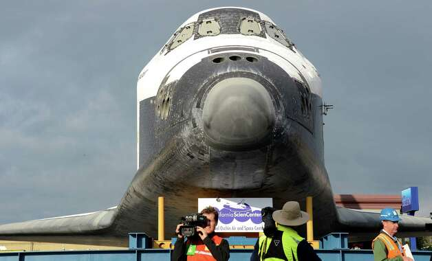Photographers take pictures of the Space Shuttle Endeavour as it rests during its first temporary stop at Westchester square. Photo: Joe Klamar / AFP/Getty Images
