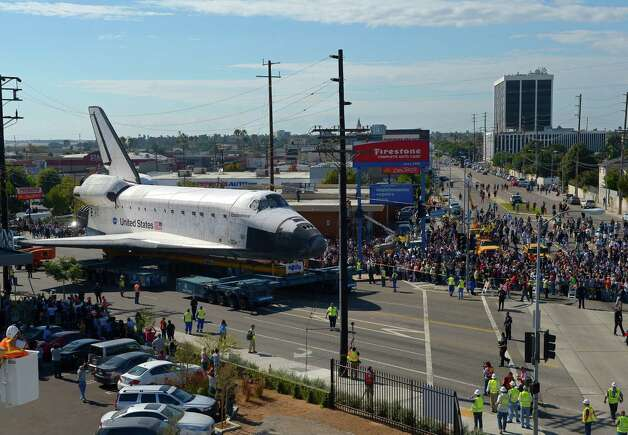 The Space Shuttle Endeavour is moved slowly along a city street. Photo: Mark J. Terrill / Associated Press